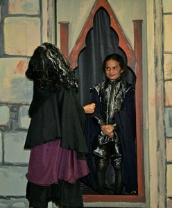 Old Woman (Jasmine Madan-Niccum) looking into the mirror (Tessa Snyder)