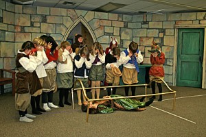 Funeral scene with dwarfs, animals and Snow White (The Dwarves: Jaden Muelman, Lillian Rex, Sydney Peterson, Brooklynn Winters, Ariana Panerio, Asher Hildebrand, Agrya Alley, Marina Matty, Prajna Alley).