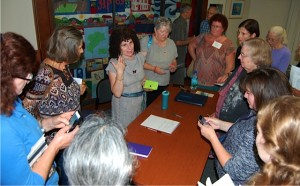 County Library Director Teresa Landers (center, gray dress) talks with a group of Aptos Library supporters
